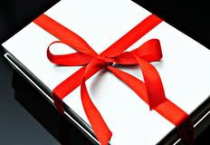 Gray box with red ribbon Stock Photos