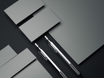 Gray branding mockup with silver pens. 3d rendering. Gray branding mockup with silver pens on dark floor. 3d rendering Stock Photos