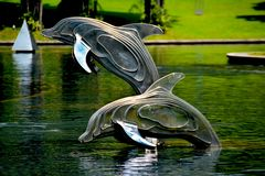 Gray and Brass Metal Dolphin Pool Decor Royalty Free Stock Images