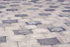 Gray brick stone street road. Light sidewalk Royalty Free Stock Photo