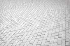 Gray brick stone street road. Light sidewalk Stock Images