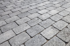 Gray brick urban pavement, background texture Royalty Free Stock Photo