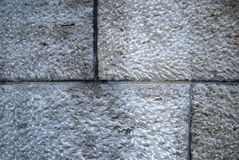 Gray brick wall. Closeup of light gray bricks in a wall Stock Photos