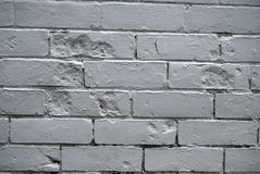 Gray brick wall. Details of an old, worn, gray brick wall Royalty Free Stock Photography