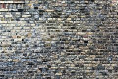 Gray brick wall. Cracked gray brick wall, blocks in a line background stock photography
