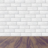 Gray brick wall with laminate floor Royalty Free Stock Images