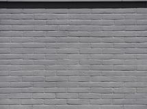 Gray brick wall under the sunlight. Background and texture. stock images