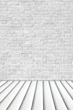 Gray brick wall on white metal sheet floor. royalty free stock images
