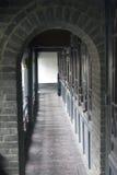 Gray bricks arch wood floor Stock Image