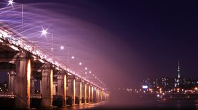 Gray Bridge With Street Light during Nighttime Stock Images