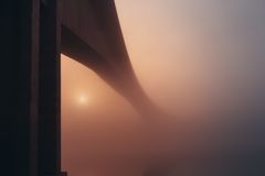 Gray Bridge Surrounded by White Fog during Sunset Stock Image