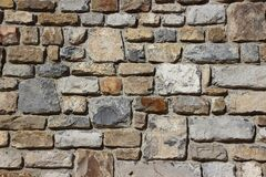 Gray Brown and Black Brick Stone Wall Royalty Free Stock Images