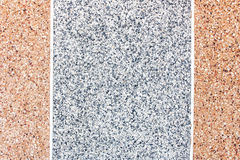 Gray and brown exposed aggregate finish Stock Image