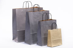 Gray and brown paper bags with handles for shopping Stock Image