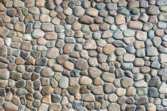 Gray and brown pebble stone wall Royalty Free Stock Photography