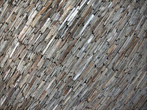 Gray and brown stone pattern. Rugged surface of layered stones in gray, silver and brown Royalty Free Stock Photography