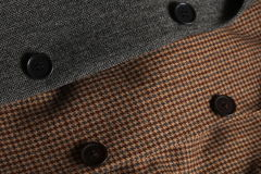 Gray and brown tweed coats overlapping Royalty Free Stock Images