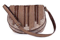 Gray and brown women's purse with leather stripes Stock Photo