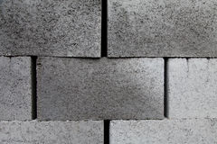 Gray building  cinder blocks made of cement stacked close-up background. Stock Images