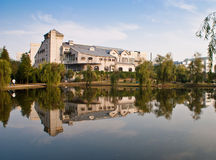 A gray building by a lake. On campus Stock Images