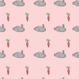 Gray bunnies and carrots Royalty Free Stock Photo