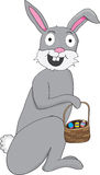 Gray bunny with easter basket. Gray easter bunny with basket and eggs Stock Images