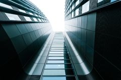 Gray business center, modern architecture. Berlin modern architecture. Gray business center. Symmetry picture Royalty Free Stock Photo