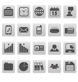 Gray business icons on gray squares Royalty Free Stock Photos