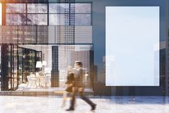 Gray cafe exterior with a big poster, people. Gray cafe exterior with large windows, a big vertical poster and two business people passing by. 3d rendering mock Royalty Free Stock Photos