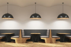 Gray cafe interior with sofas and lamps, side Royalty Free Stock Images