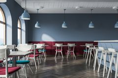 Gray cafe interior. With a wooden floor, a bar with stools and square tables with blue chairs near them. Soft red sofas along the walls. 3d rendering mock up Stock Images