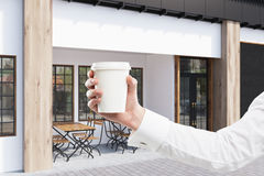 Gray cafe and man with coffee Royalty Free Stock Photos