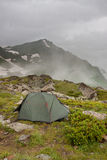 Gray camping tent in the mist. Stock Images