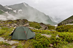 Gray camping tent in mountains. Royalty Free Stock Photo
