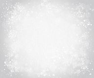 Gray canvas background with snowflakes Royalty Free Stock Photos