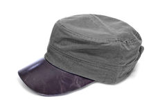 A gray cap with brown leather visor Royalty Free Stock Photography