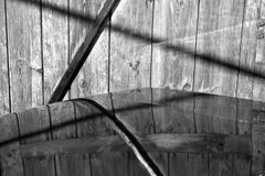 Gray car in front of wooden wall in black and white Royalty Free Stock Photos