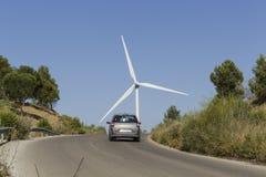 Gray car reaches the top of a mountainous road Royalty Free Stock Photos