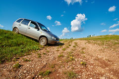 Gray car standing in a field Stock Photography