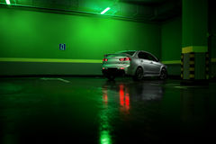 Gray car stay at underground parking lot and reflect in wet asphalt. Gray car stay at underground parking lot and reflect in the wet asphalt Royalty Free Stock Image