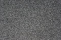 Gray carpet for the background texture. Felted fabric dark color for the background texture royalty free stock photos