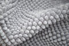 Gray carpet texture. Doormat carpet closeup. Pattern, details. Light gray carpet texture. Doormat carpet closeup. Pattern, details. Gray background stock photo