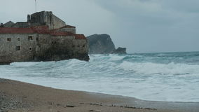 Gray castle washed by sea waters in autumn day. stock video footage