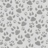 Gray cat paw prints seamless pattern background. Gray cat paw prints seamless and repeating pattern background with texture stock image