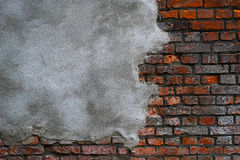 Gray cement plaster on  brick wall Royalty Free Stock Photography
