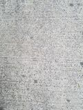 Gray cement soft gray with dark flecks and other variations. Outdoor photography natural light. Urban city street background texture. Real view of sidewalk royalty free stock image