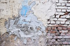 Gray cement. Uneven wall of the wall. Old architecture. Dirty bricks.  royalty free stock photography