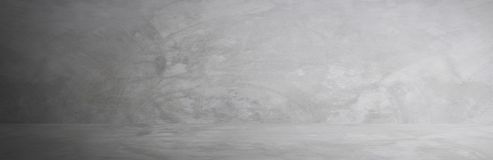 Gray cement wall studio and blank floor background for present product.  stock images
