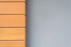 Gray cement wall with teak wood. Gray cement wall with teak wood wall background Royalty Free Stock Photo