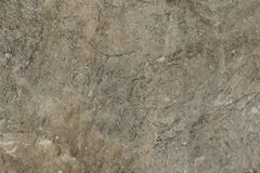 Gray cement wall texture, concrete surface closeup. Grunge rock backdrop, building decoration Stock Photography